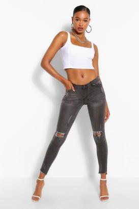 boohoo Low Rise Rip Knee Skinny Jeans