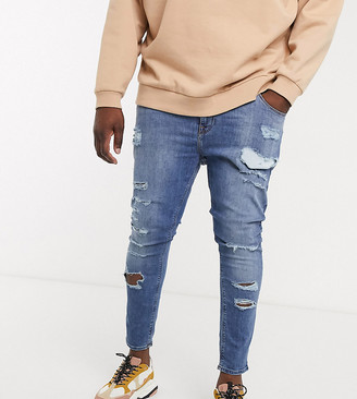 ASOS DESIGN Plus spray on jeans in power stretch denim in mid wash blue with heavy rips