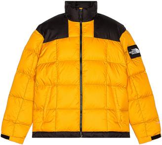 The North Face Black Lhotse Jacket in Summit Gold | FWRD
