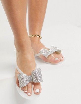 ASOS DESIGN Fatima thongs with embellished bows in white