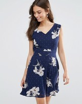 Yumi Tie Back Skater Dress In Floral & Polka Dot