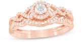 Zales 3/8 CT. T.W. Diamond Frame Twist Bridal Set in 10K Rose Gold