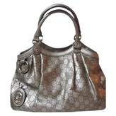 Gucci Sukey Gold Leather Handbags