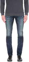Diesel Thavar-ne slim-fit tapered stretch-denim jeans