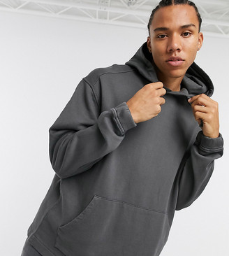 ASOS DESIGN Tall oversized hoodie with fixed hem in washed black