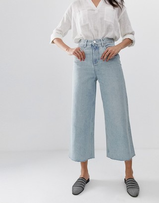 ASOS DESIGN premium wide leg jeans in light vintage wash blue