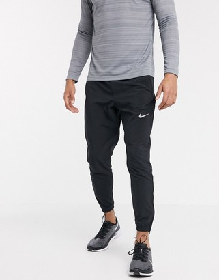 Nike Running essential woven joggers in black