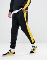 Granted Joggers In Black Nylon With Yellow Stripe