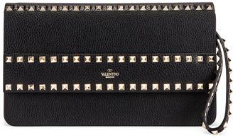 Valentino Rockstud Clutch in Black | FWRD