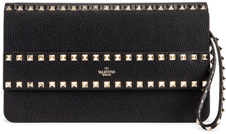 Valentino Rockstud Clutch in Black | FWRD