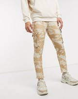 Asos Design DESIGN skinny jeans in camo print with cargo pockets