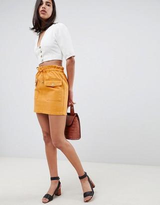 Asos DESIGN denim paperbag skirt in mustard