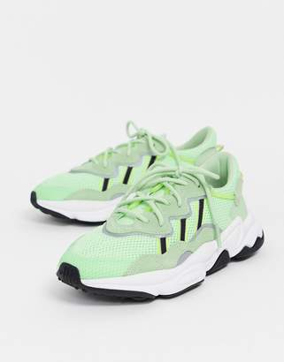adidas Ozweego trainers in neon green