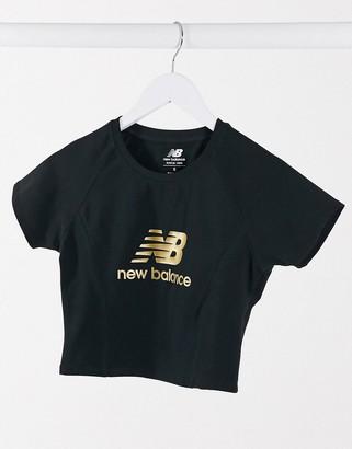 New Balance cropped metallic logo t-shirt in black