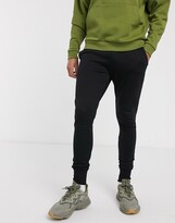 Asos Design DESIGN super skinny joggers with deep rib cuff in black