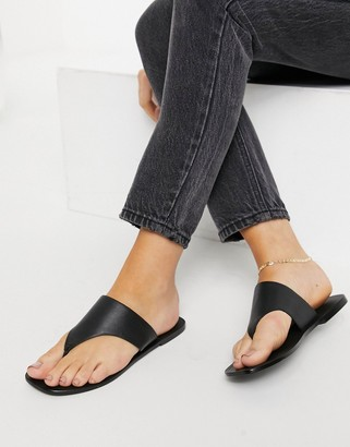 ASOS DESIGN Folly leather toe thong sandals in black