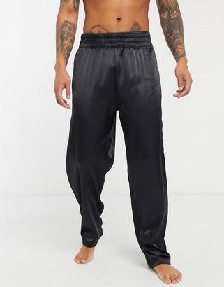 ASOS DESIGN lounge pyjama bottoms in black satin