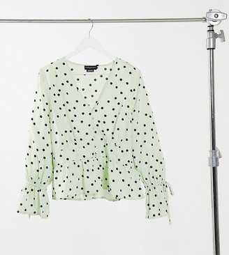Wednesday's Girl Curve tea blouse with tie cuffs in scattered spot