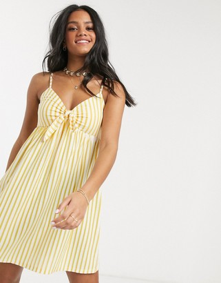 ASOS DESIGN cami bow front mini sundress in mustard and white stripe