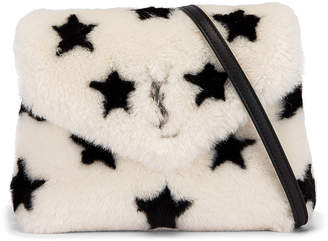 Saint Laurent Toy Loulou Star Shearling Pouch Bag in Natural & Black | FWRD