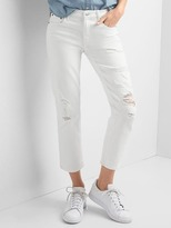 Mid rise destructed slim crop jeans