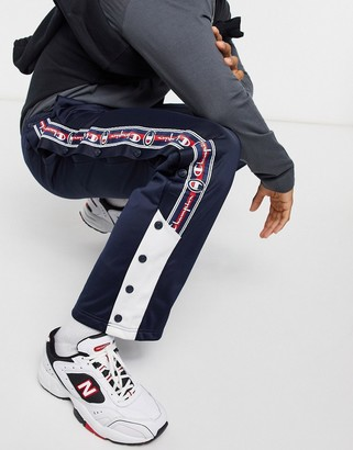 Champion popper trousers with side tape detail in navy