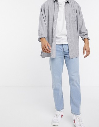 ASOS DESIGN relaxed tapered jeans in dusty blue