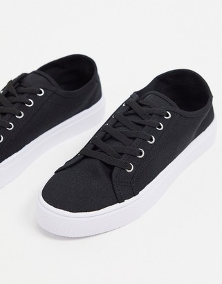 ASOS DESIGN Dizzy lace up trainers in black