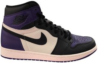 Jordan Air 1 Purple Leather Trainers