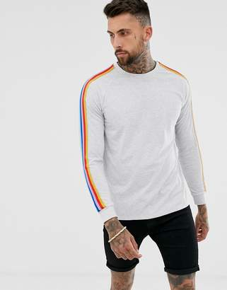 Asos Design DESIGN relaxed long sleeve t-shirt with contrast rainbow taping in white marl
