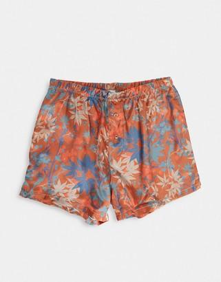 ASOS DESIGN woven satin boxer short in orange abstract floral