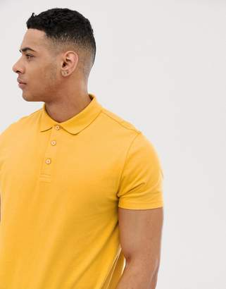 Asos Design DESIGN polo in jersey in yellow