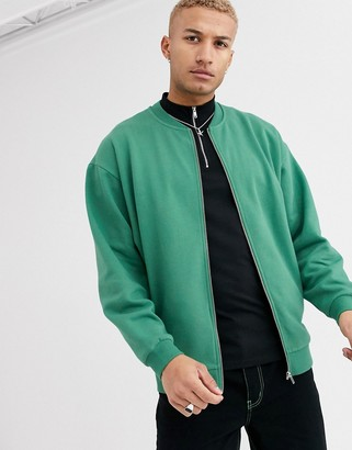 Asos Design DESIGN oversized jersey bomber jacket with silver side zips in green
