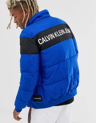 Calvin Klein Jeans puffer jacket in blue with chest stripe