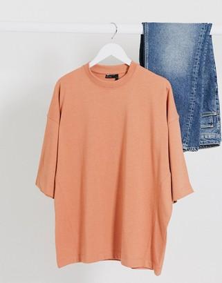 ASOS DESIGN oversized t-shirt with side seam detail in orange marl