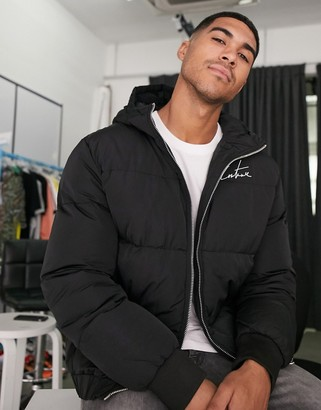 The Couture Club signature piped panel puffer jacket in black
