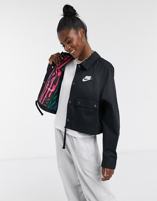 Nike cropped woven jacket in black with printed lining