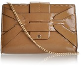 Melie Bianco Emily patent clutch with geometric flap over closure
