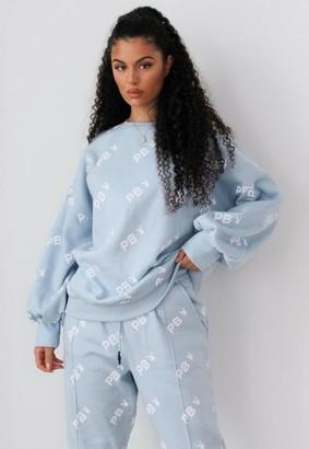 Missguided x Petite Blue Repeat Print Oversized Sweatshirt