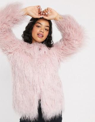 Asos DESIGN mongolian faux fur coat in pink