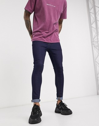 Asos Design DESIGN spray on jeans in power stretch denim in Indigo-Blue