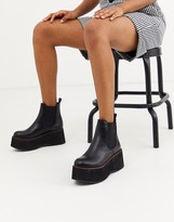 Koi Footwear vegan extreme platform ankle boots in black with red stitching