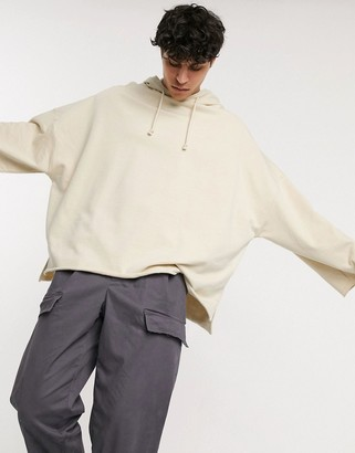 ASOS DESIGN organic extreme oversized hoodie with raw edges in beige