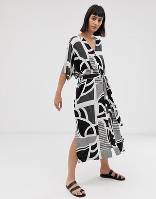 Weekday tie waist dress in black and white eye print