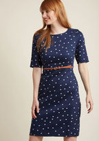 D0065 There's no question that wearing this navy sheath dress from Sugarhill Boutique will fill your day with joy! Passersby will take delight in spying the white kitty print of this belted frock - and all their compliments on your stellar look will leave you f