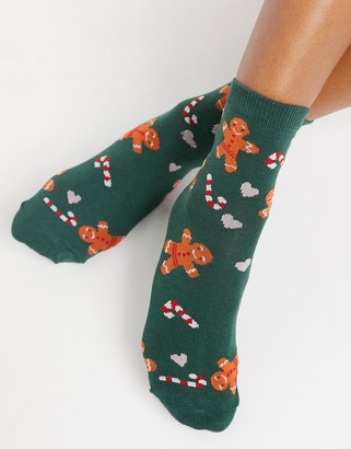 ASOS DESIGN Christmas gingerbread and candy ankle socks in green