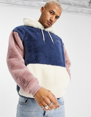 ASOS DESIGN oversized faux-fur colorblock hoodie in blue, pink, and cream