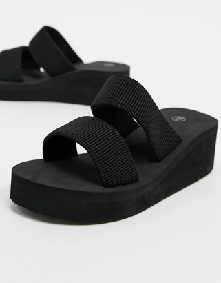 Truffle Collection flatform mules in black