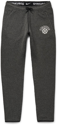 NRG + Gyakusou Na Kyma Tapered Logo-Print Stretch-Knit Sweatpants
