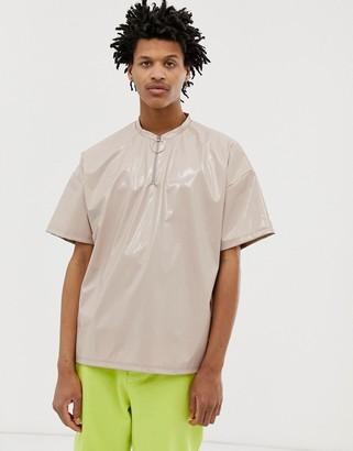 Asos Design DESIGN oversized t-shirt with half sleeve and zip neck in vinyl fabric-Beige